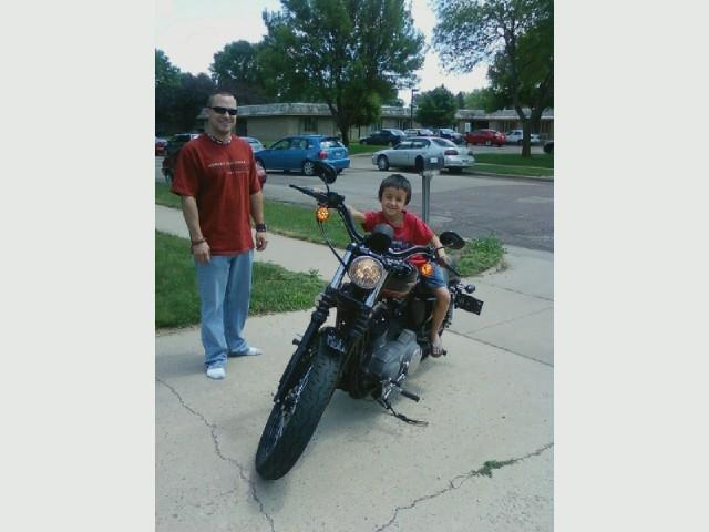 Greg Jr's son Dominic on a motorcycle